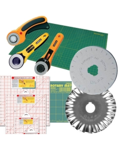 Rotary fabric cutters, mats and patchwork rule